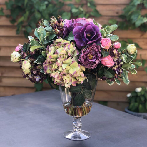 Faux flower arrangement with dusky blooms by Twilight Trees
